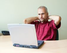 Thoughtful Office Worker Royalty Free Stock Images