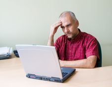 Thoughtful Office Worker Stock Photography