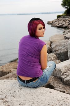 Girl Sitting On Lakeshore. Royalty Free Stock Images