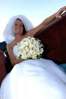 Happy Young Bride In Convertible Stock Photo
