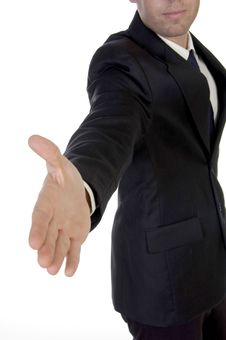 Free Young Man In Suit Offering To Shake The Hand Stock Photos - 6498433