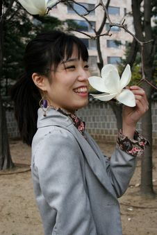 Free Pretty Korean Woman Holding A Flower Stock Photography - 659032