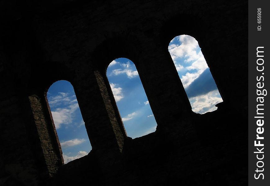 Ancient gothic windows with blue sky behind