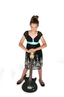 Free Pretty Girl In Black Dress With Electric Guitar Stock Images - 6504534