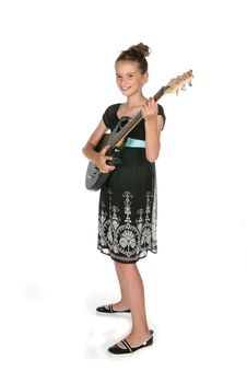 Free Cute Young Girl Holding Electric Guitar Royalty Free Stock Image - 6504536