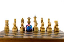 Globe And Wooden Chess Figures Royalty Free Stock Images