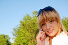 Beautiful Young Woman Speaking The Phone Royalty Free Stock Image