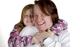 Free Grandmother And Granddaughter Cuddling Stock Image - 6514301