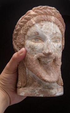 Ancient Greek Statue Of A God In Hand Isolated Stock Photo