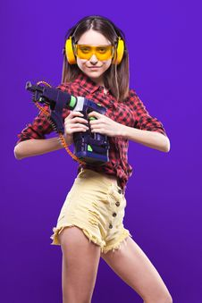 Free Waist Picture Girl-builder In Hearing Protection And Protec Stock Photos - 65127813