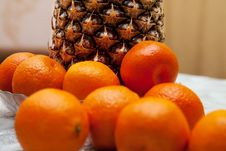 Free Tangerines And Pineapple Royalty Free Stock Image - 65176016