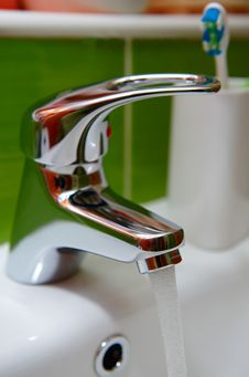 White Sink Faucet Metal Tile Royalty Free Stock Images