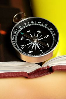 Free Magnetic Compass On A Book Royalty Free Stock Photo - 6524155