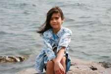 Nine Year Old Girl Sitting By Lake Royalty Free Stock Photos