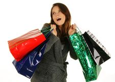 Free Shopping Happy Woman. Isolated Over White Backgrou Royalty Free Stock Image - 6530196