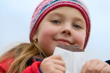 Free Young Girl Eats Chocolate Royalty Free Stock Photos - 6531348