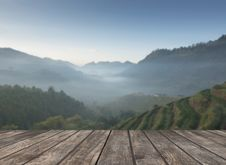 Free Wooden Table And The Tea Plantations Background Stock Image - 65321411