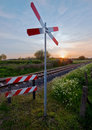 Free Railway Tracks With Pastel Sunset And Traffic Sign Royalty Free Stock Photo - 6540045