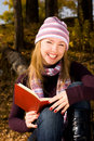 Free Girl Reading A Book In The Park Stock Image - 6547941