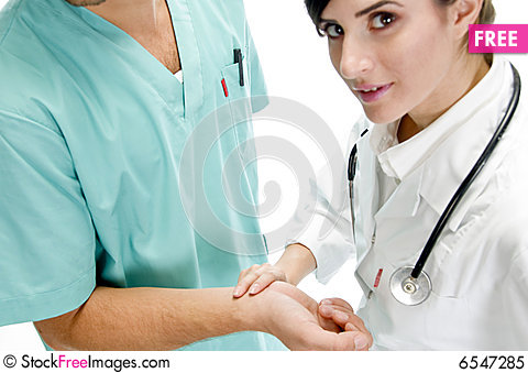 Free Young Nurse Checking Pulse Of Patient Royalty Free Stock Photo - 6547285
