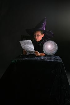 Free Wizard Child Reading A Spell Stock Photos - 6541203