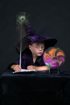 Free Wizard Looking Into Crystal Ball Stock Photo - 6541210