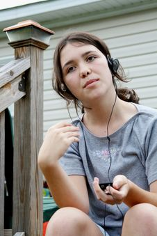 Girl Listening To Mp3 Stock Photos