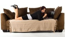 Free Lady Lying Working On Couch Royalty Free Stock Photography - 6542317