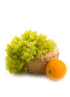 Basket With Green Grapes And Beautiful Ripe Orange Royalty Free Stock Photography