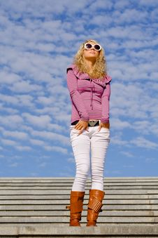 Free Beautiful Girl Standing Against Blue Sky Royalty Free Stock Photo - 6549155