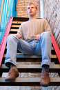 Free Young Stylish Man Sit On Stairs Near Brick Wall. Royalty Free Stock Images - 6558189