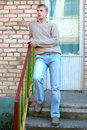 Free Young Stylish Man Stay On Stairs Near Brick Wall. Royalty Free Stock Photos - 6558238