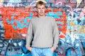 Free Young Stylish Man Stand Near Graffiti Brick Wall. Royalty Free Stock Photography - 6558337