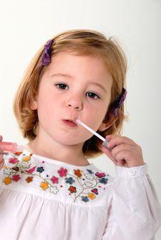 Free Toddler Playing Makeup Stock Photos - 6550543