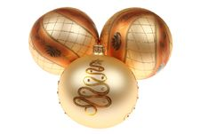Three Golden Christmas Baubles Royalty Free Stock Photos