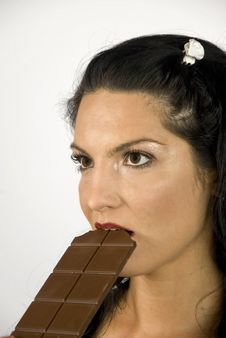 Free Woman Biting Chocolate Royalty Free Stock Image - 6551786