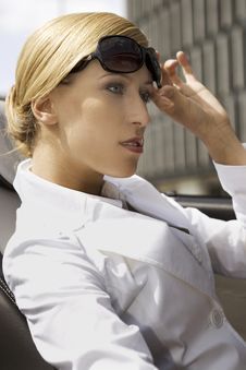Blonde Businesswoman In A Car