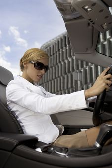 Blonde Businesswoman In A Car Royalty Free Stock Photo