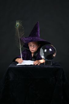 Free Wizard Child Writing A Spell Stock Images - 6555634