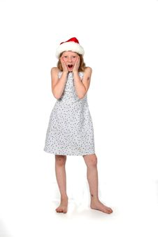 Free Santa Hat Girl With Hands On Face Stock Image - 6556931