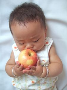 Free Pretty Baby And Red Apple Stock Photo - 6557880