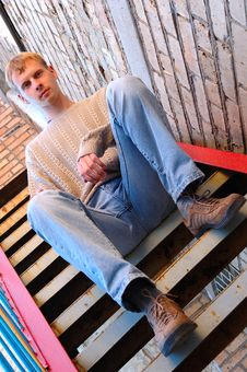 Free Young Stylish Man Sit On Stairs Near Brick Wall. Royalty Free Stock Image - 6558196