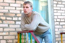 Free Young Stylish Man Stay On Stairs Near Brick Wall. Royalty Free Stock Photography - 6558247