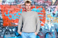 Free Young Stylish Man Stand Near Graffiti Brick Wall. Royalty Free Stock Photography - 6558337