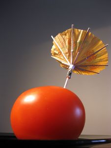 Tomato With Umbrella Royalty Free Stock Photography