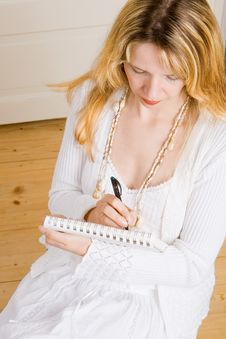 A Business Woman Taking Notes Stock Images