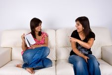 Free Twin Sisters In Sofa Talking About A Book Stock Photos - 6566393