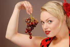 Free Pretty Girl With Red Grapes Stock Images - 6567104