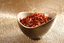 Free Crushed Red Hot Chilli Pepper In Bowl On Golden Stock Photo - 6568740
