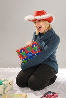 Excited Girl With Xmas Gift Stock Image